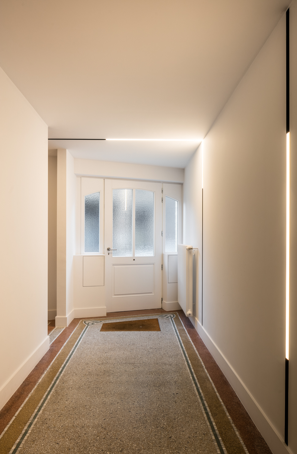 defining the original floor elements in this hallway with integrated LED lighting